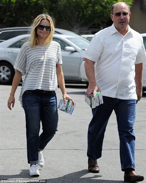 Kristen Bell covers her burgeoning baby bump with loose